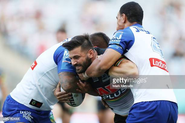 Josh Mansour of the Panthers is tackled during the round three NRL match between the Bulldogs and the Panthers at ANZ Stadium on March 23 2018 in...