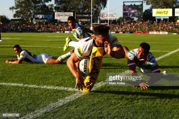 Josh Mansour of the Panthers is tackled into touch during the round two NRL match between the Penrith Panthers and the South Sydney Rabbitohs at...