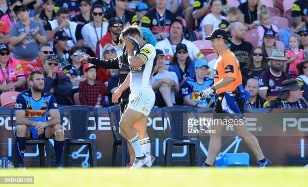 Josh Mansour of the Panthers leaves the field with a fractured cheekbone during the round six NRL match between the Penrith Panthers and the Gold...