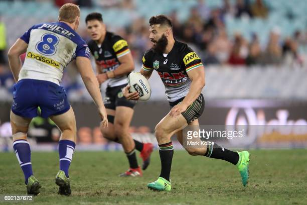 Josh Mansour of the Panthers runs the ball during the round 13 NRL match between the Canterbury Bulldogs and the Penrith Panthers at ANZ Stadium on...