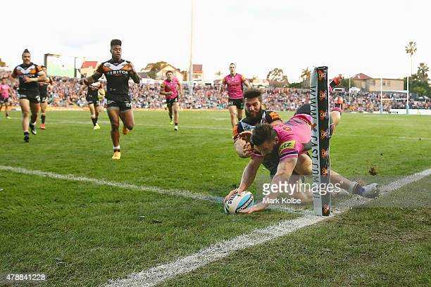Josh Mansour of the Panthers scores a try during the round 16 NRL match between the Wests Tigers and the Penrith Panthers at Leichhardt Oval on June...