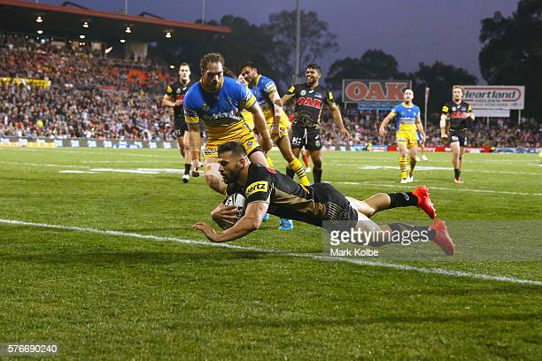 Josh Mansour of the Panthers scores a try during the round 19 NRL match between the Penrith Panthers and the Parramatta Eels at Pepper Stadium on...