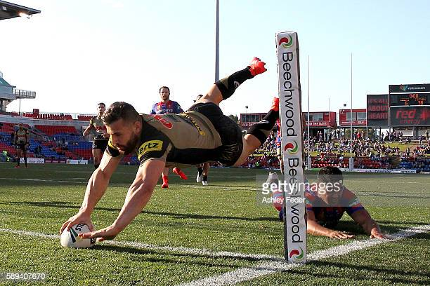 Josh Mansour of the Panthers scores a try during the round 23 NRL match between the Newcastle Knights and the Penrith Panthers at Hunter Stadium on...