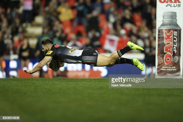 Josh Mansour of the Panthers scores a try during the round 23 NRL match between the Penrith Panthers and the North Queensland Cowboys at Pepper...