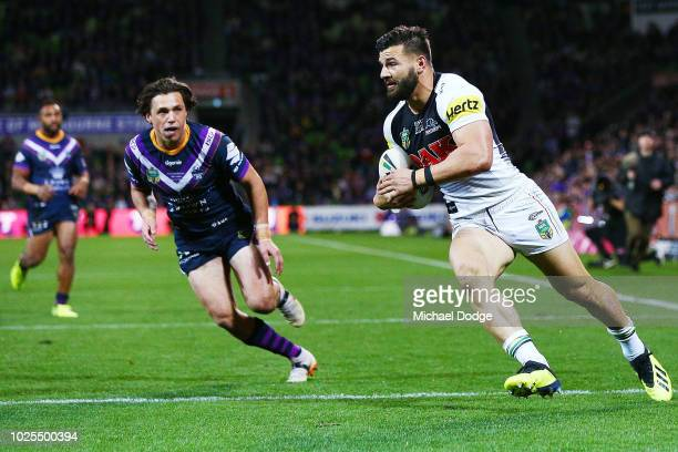 Josh Mansour of the Panthers scores a try during the round 25 NRL match between the Melbourne Storm and the Penrith Panthers at AAMI Park on August...