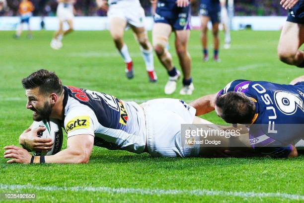 Josh Mansour of the Panthers scores a try past Cameron Smith of the Storm during the round 25 NRL match between the Melbourne Storm and the Penrith...