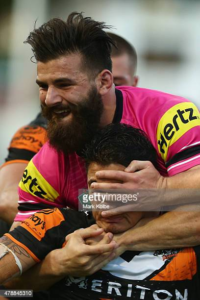 Josh Mansour of the Panthers tackles Delouise Hoeter of the Wests Tigers during the round 16 NRL match between the Wests Tigers and the Penrith...