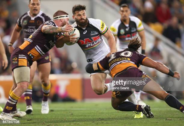 Josh Mansour of the Panthers takes a tackle during the NRL Semi Final match between the Brisbane Broncos and the Penrith Panthers at Suncorp Stadium...