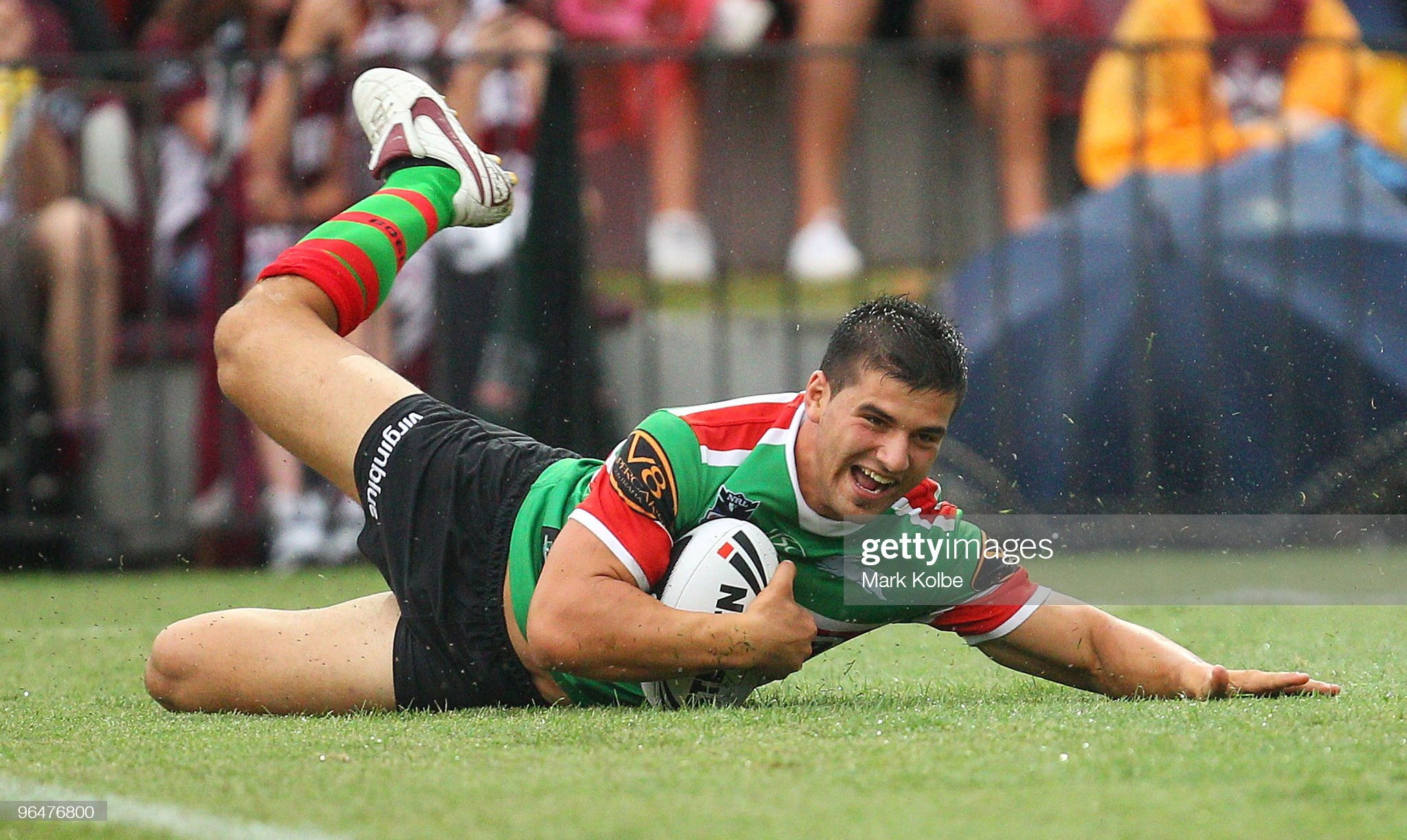 josh-mansour-of-the-rabbitohs-dives-over-to-score-a-try-during-the-picture-id96476800