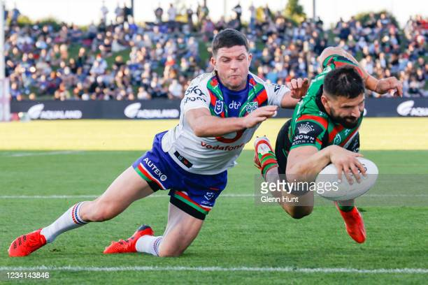 Josh Mansour of the Rabbitohs scores a try during the round 19 NRL match between the South Sydney Rabbitohs and the New Zealand Warriors at Sunshine...