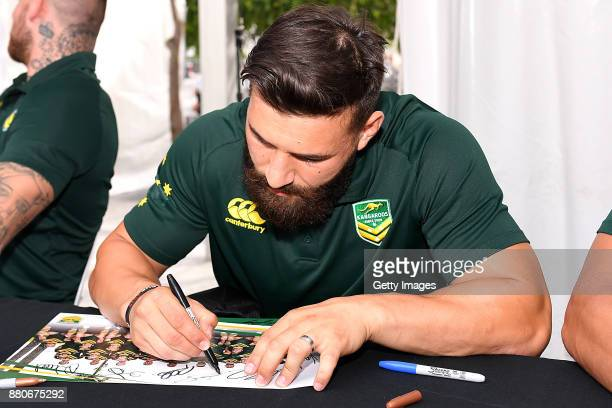 Josh Mansour signs autographs during an Australia Kangaroos and England Lions Signing Session at Reddacliff Place on November 28 2017 in Brisbane...