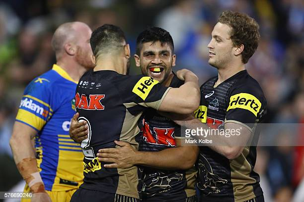 Josh Mansour Tyrone Peachey and Matt Moylan of the Panthers celebrate Tyrone Peachey scoring a try during the round 19 NRL match between the Penrith...