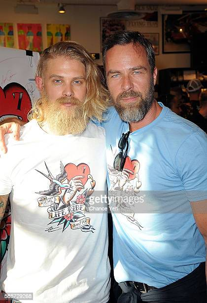 Josh Mario John and JR Bourne attend 7th annual LifeRide for amfAR at Kiehl's Since 1851 Flagship Store on August 3, 2016 in New York City.