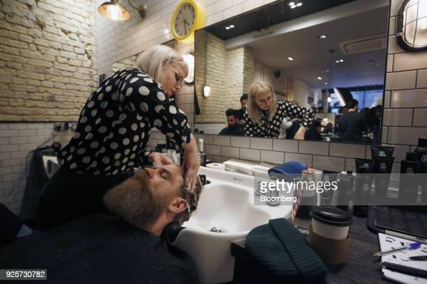 Josh Mario John, model and lifestyle blogger, has his hair washed during a launch event for House 99, a grooming brand for men created by former...