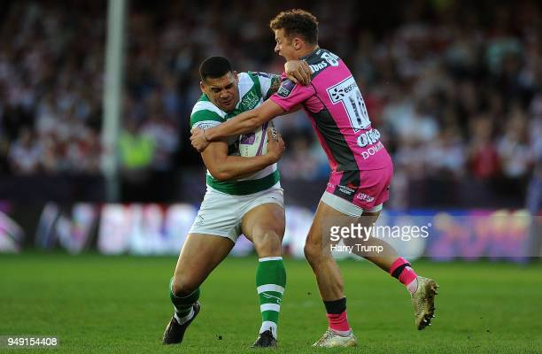 Josh Matavesi of Newcastle Falcons is tackled by Billy Burns of Gloucester Rugby during the European Challenge Cup SemiFinal match between Gloucester...