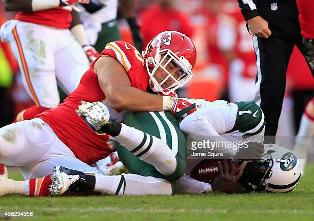 Josh Mauga of the Kansas City Chiefs tackles Michael Vick of the New York Jets during the game at Arrowhead Stadium on November 2 2014 in Kansas City...