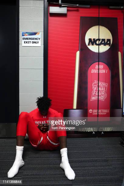 Josh Mballa of the Texas Tech Red Raiders reacts in the locker room after his teams 85-77 loss to the Virginia Cavaliers in the 2019 NCAA men's Final...