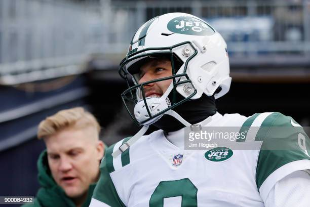 Josh McCown and Bryce Petty of the New York Jets walk onto the field before the game against the New England Patriots at Gillette Stadium on December...