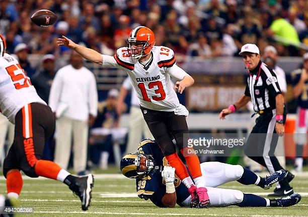 Josh McCown of the Cleveland Browns throws the ball while avoiding the sack by Aaron Donald of the St Louis Rams in the first quarter at the Edward...