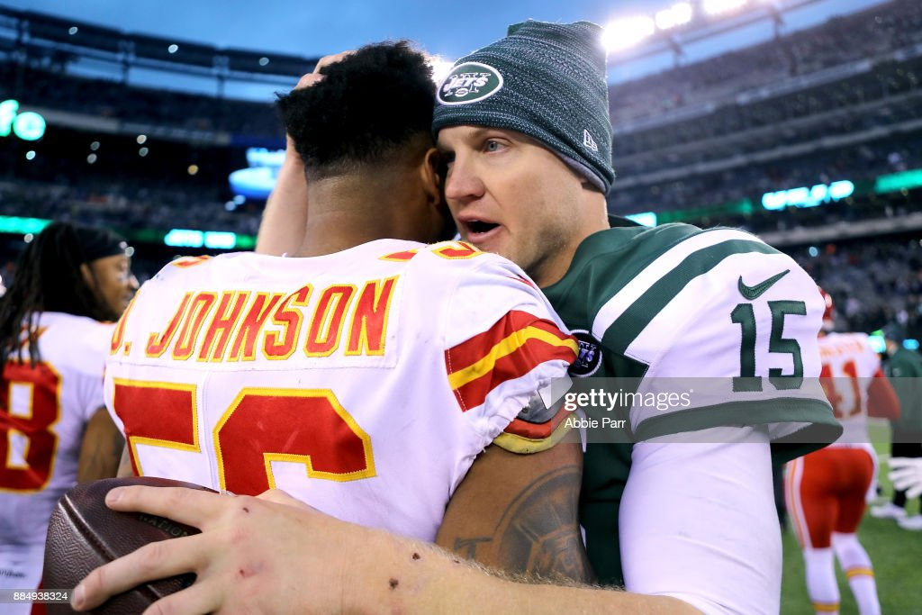 Josh McCown #15 of the New York Jets and Derrick Johnson #56 of the Kansas City Chiefs hug following the Jets' 38-31 win during their game at MetLife Stadium on December 3, 2017 in East Rutherford, New Jersey.