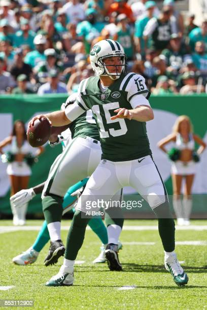 Josh McCown of the New York Jets attempts a pass against the Miami Dolphins during the first half of an NFL game at MetLife Stadium on September 24...