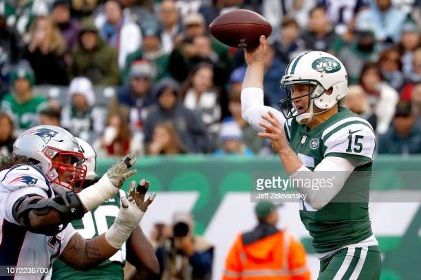 Josh McCown of the New York Jets attempts a pass against the New England Patriots during the first half at MetLife Stadium on November 25 2018 in...