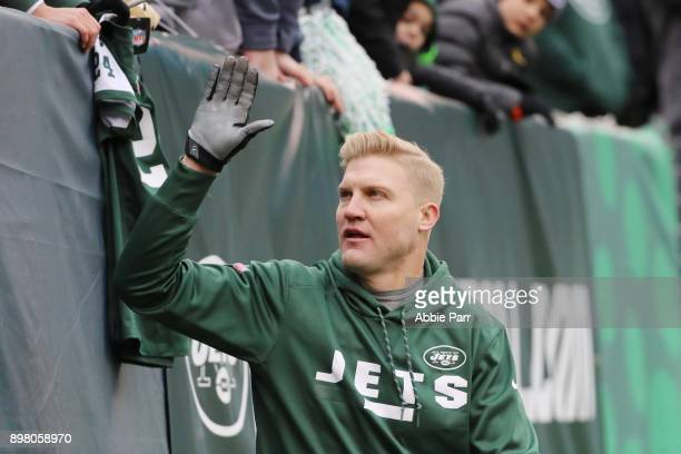 Josh McCown of the New York Jets high fives the fans prior to an NFL game against the Los Angeles Chargers at MetLife Stadium on December 24 2017 in...