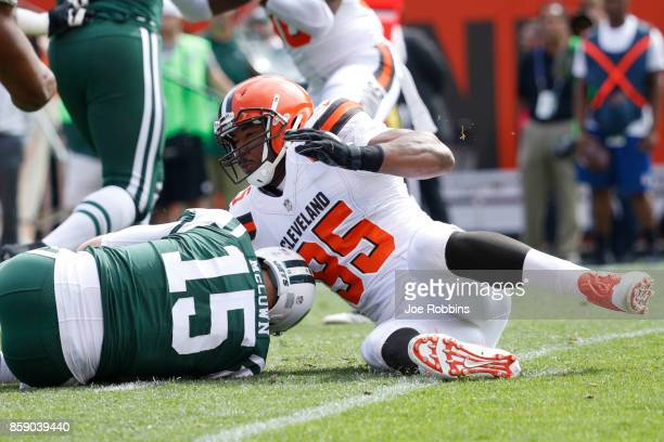 Josh McCown of the New York Jets is sacked by Myles Garrett of the Cleveland Browns in the first quarter at FirstEnergy Stadium on October 8 2017 in...