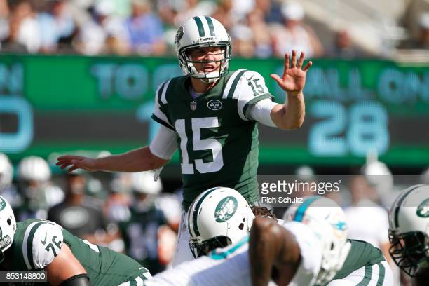 Josh McCown of the New York Jets sets the play against the Miami Dolphins during the second half of an NFL game at MetLife Stadium on September 24...