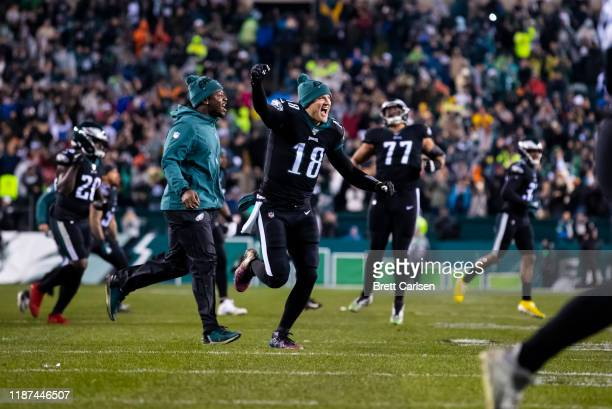 Josh McCown of the Philadelphia Eagles runs onto the field in celebration of his teams win against the New York Giants in overtime at Lincoln...
