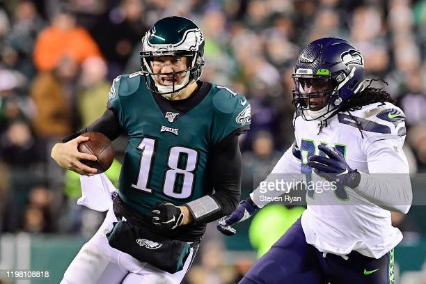 Josh McCown of the Philadelphia Eagles runs the ball against Ziggy Ansah of the Seattle Seahawks in the NFC Wild Card Playoff game at Lincoln...