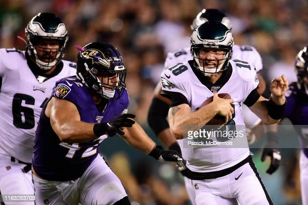 Josh McCown of the Philadelphia Eagles scrambles with the ball against Patrick Ricard of the Baltimore Ravens in the first half during a preseason...