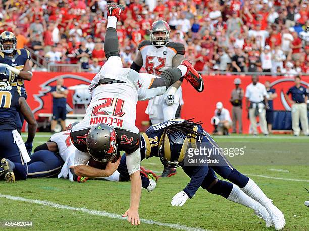 Josh McCown of the Tampa Bay Buccaneers flips into the end zone to score a touchdown during the second half of the game against the St Louis Rams at...