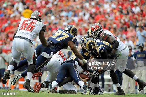 Josh McCown of the Tampa Bay Buccaneers is sacked during the first half of the game against the St Louis Rams at Raymond James Stadium on September...