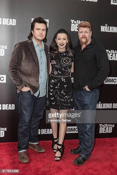 Josh McDermit Christian Serratos and Michael Cudlitz arrive at AMC presents live 90minute special edition of 'Talking Dead' at Hollywood Forever on...