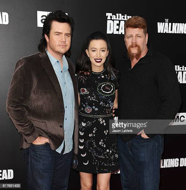 Josh McDermitt Christian Serratos and Michael Cudlitz attend the live 90minute special edition of 'Talking Dead' at Hollywood Forever on October 23...