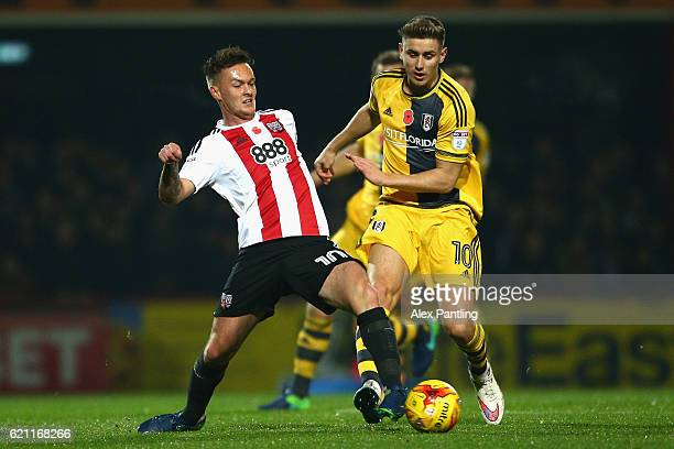 Josh McEachran of Brentford and Tom Cairney of Fulham battle for posession during the Sky Bet Championship match between Brentford and Fulham at...