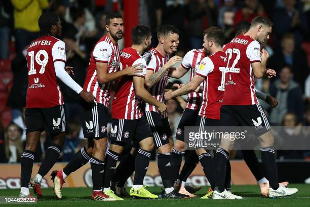 Josh McEachran of Brentford celebrates with team mates after scoring during the Sky Bet Championship match between Brentford and Birmingham City at...