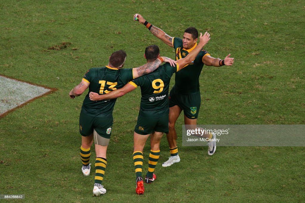 Josh McGuire, Cameron Smith and Dane Gagai of Australia celebrate victory at the end of the 2017 Rugby League World Cup Final between the Australian Kangaroos and England at Suncorp Stadium on December 2, 2017 in Brisbane, Australia.