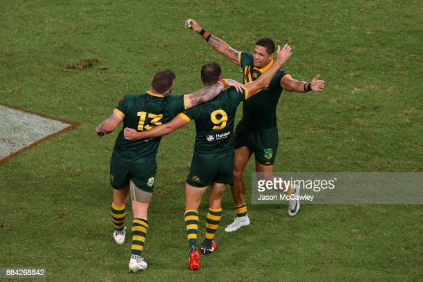 Josh McGuire Cameron Smith and Dane Gagai of Australia celebrate victory at the end of the 2017 Rugby League World Cup Final between the Australian...