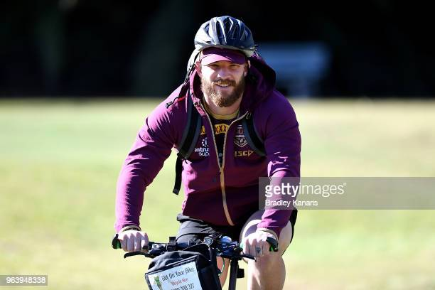 Josh McGuire is seen riding a bike during a Queensland Maroons training session at Sanctuary Cove on May 31 2018 at the Gold Coast Australia