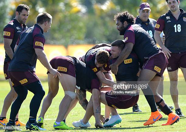 Josh McGuire is tackled during the Queensland Maroons State of Origin training session at Sanctuary Cove on May 24 2015 in Brisbane Australia