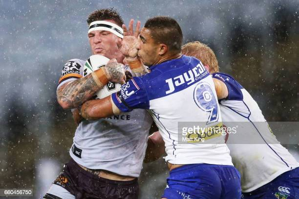 Josh McGuire of the Broncos is tackled during the round five NRL match between the Canterbury Bulldogs and the Brisbane Broncos at ANZ Stadium on...