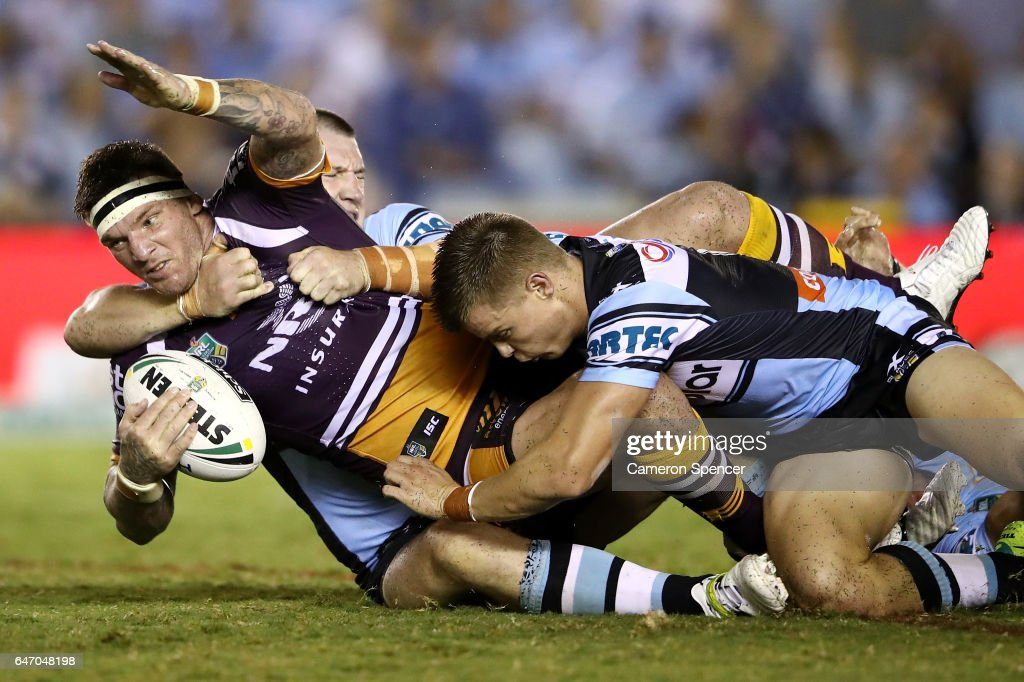 Josh McGuire of the Broncos is tackled during the round one NRL match between the Cronulla Sharks and the Brisbane Broncos at Southern Cross Group Stadium on March 2, 2017 in Sydney, Australia.