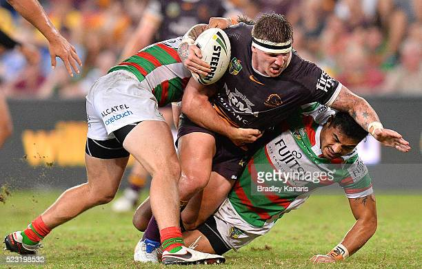 Josh McGuire of the Broncos takes on the defence during the round eight NRL match between the Brisbane Broncos and the South Sydney Rabbitohs at...