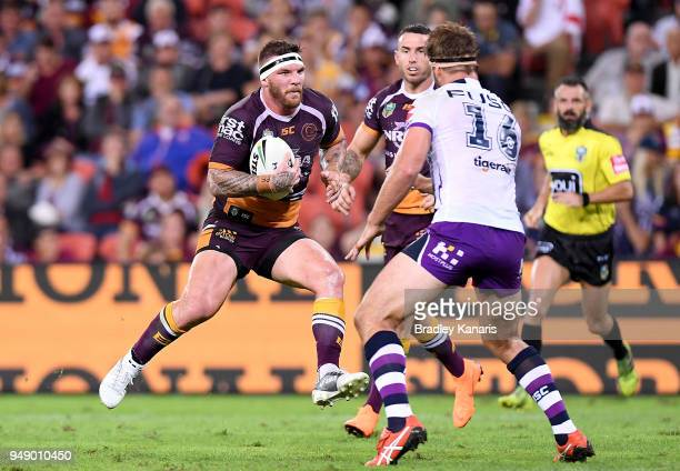 Josh McGuire of the Broncos takes on the defence during the round seven NRL match between the Brisbane Broncos and the Melbourne Storm at Suncorp...