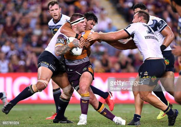 Josh McGuire of the Broncos takes on the defence during the round two NRL match between the Brisbane Broncos and the North Queensland Cowboys at...