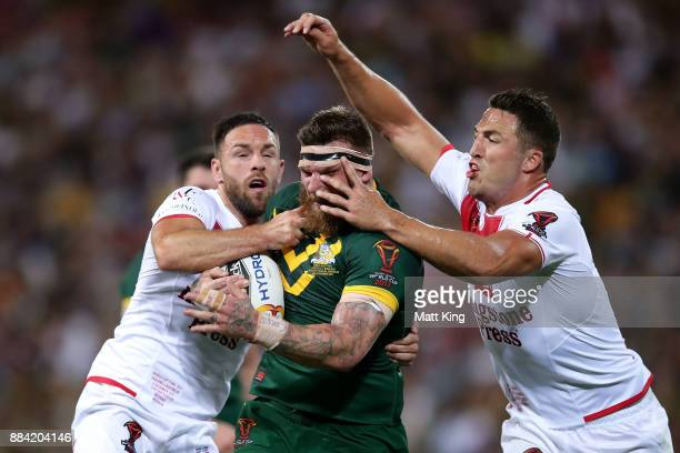 Josh McGuire of the Kangaroos is tackled during the 2017 Rugby League World Cup Final between the Australian Kangaroos and England at Suncorp Stadium...