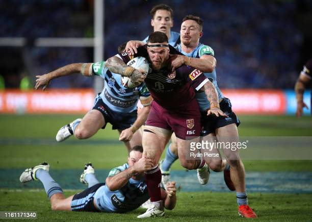 Josh McGuire of the Maroons makes a break to score a try during game three of the 2019 State of Origin series between the New South Wales Blues and...
