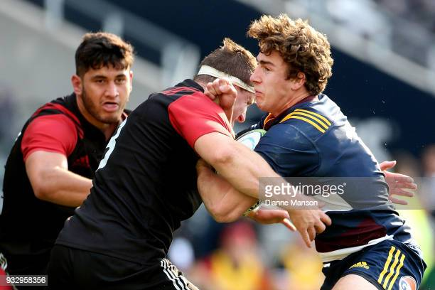 Josh McKay is tackled by Tom Sanders of the Crusaders Knights of the Highlanders Bravehearts during the match between Crusaders Knights and...